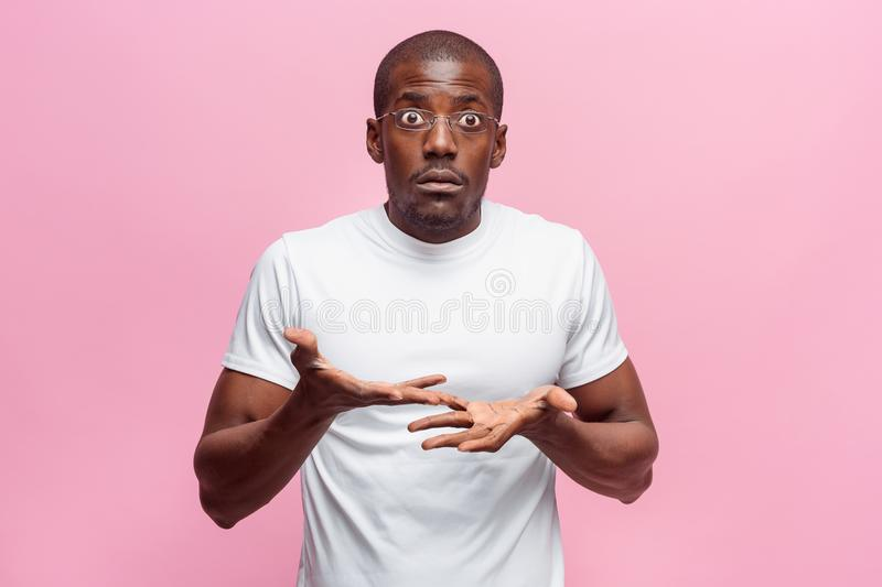 The portrait of handsome young surprised black african man stock photography