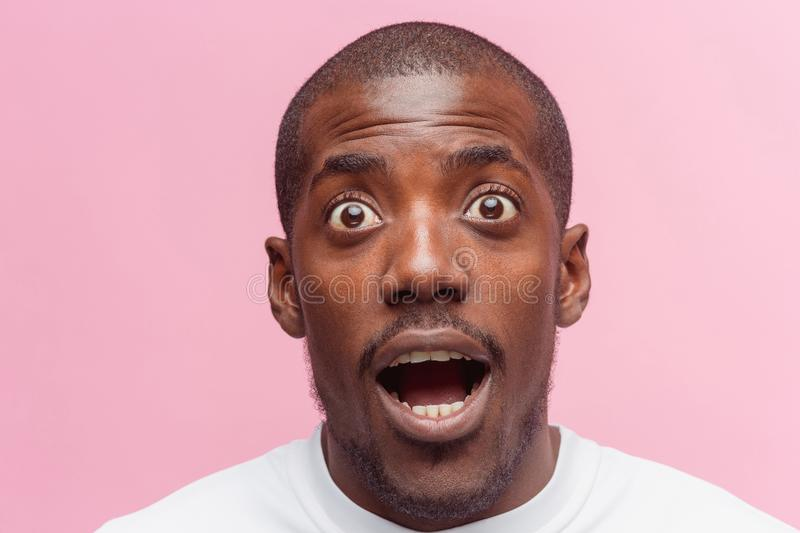 The portrait of handsome young surprised black african man royalty free stock photo