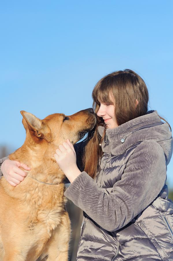 Portrait handsome young woman, kissing her good friend dog on bl stock photos