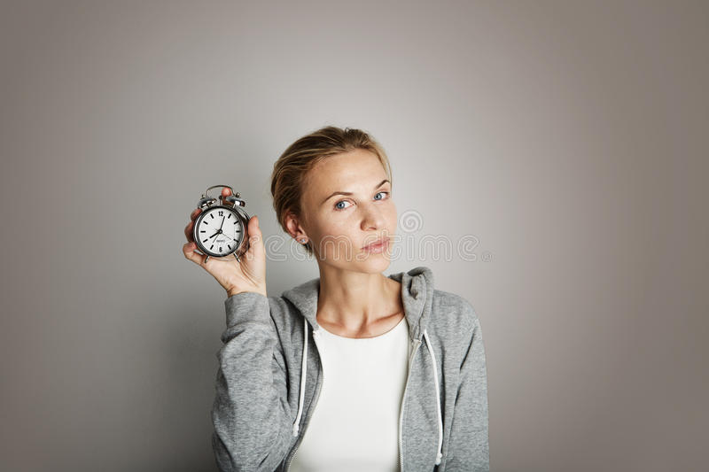 Download Portrait Handsome Young Woman Posing Blank Gray Background.Pretty Girl Smiling Holding Vintage Alarm Clock Hand Empty Stock Photo - Image of hair, care: 77046172