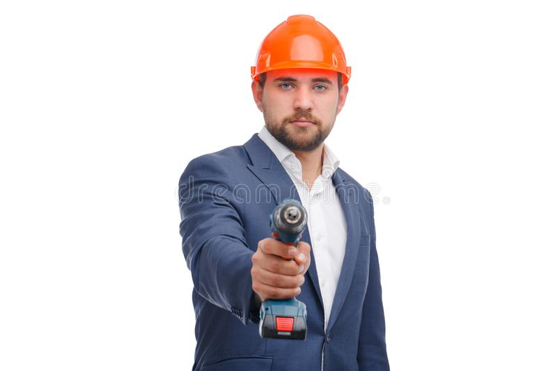 Portrait of handyman holding a drill isolated on white stock photo