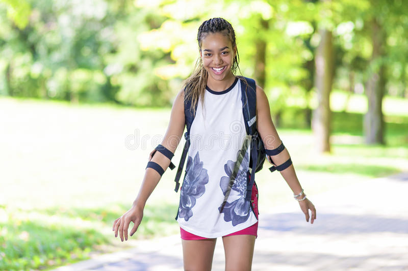 Portrait of Happy Active African American Female Teenager Having Good Time. In Park. Horizontal Image stock photos