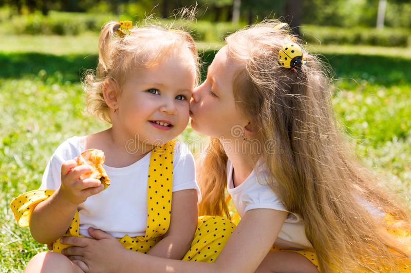 Portrait of happy adorable two sisters children girls outdoor. Cute little kid in summer day. Beautiful picture in nature royalty free stock images