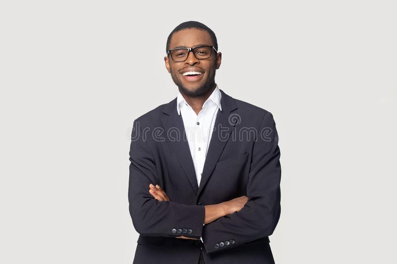 Portrait of happy african american young businessman in formal suit. royalty free stock photo