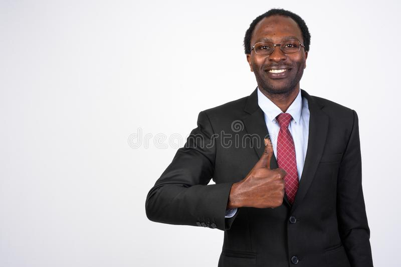 Portrait of happy African businessman giving thumbs up stock photo