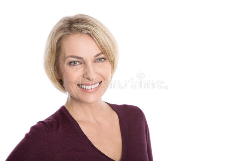 Portrait of happy aged woman over white background. royalty free stock image