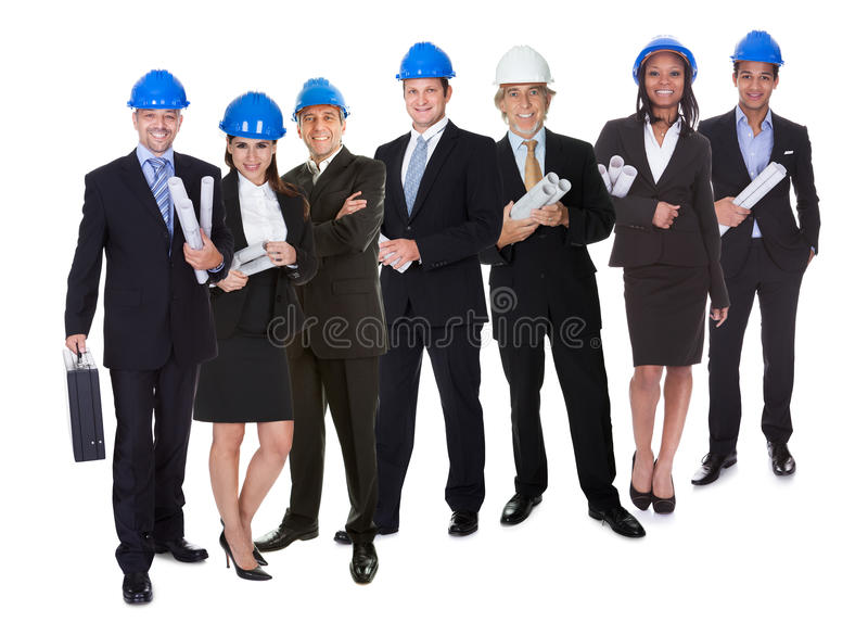 Portrait of happy architect and his team stock photography