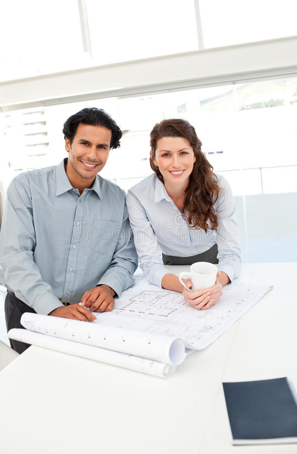 Portrait of happy architects working together royalty free stock photography