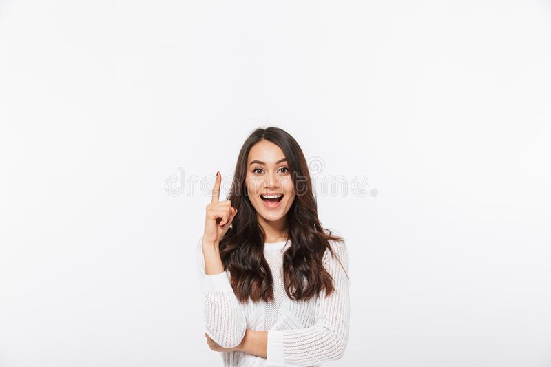 Portrait of a happy asian businesswoman pointing finger up stock images