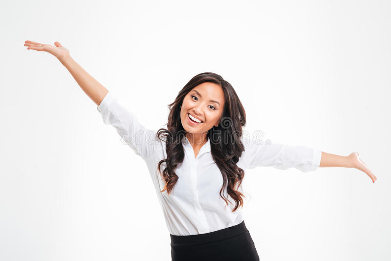 Portrait of a happy asian busineswoman with raised hands up. Over white background stock image
