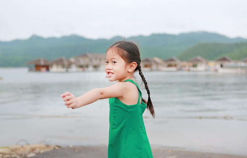 Portrait of happy Asian child girl relaxes in hillside royalty free stock photos