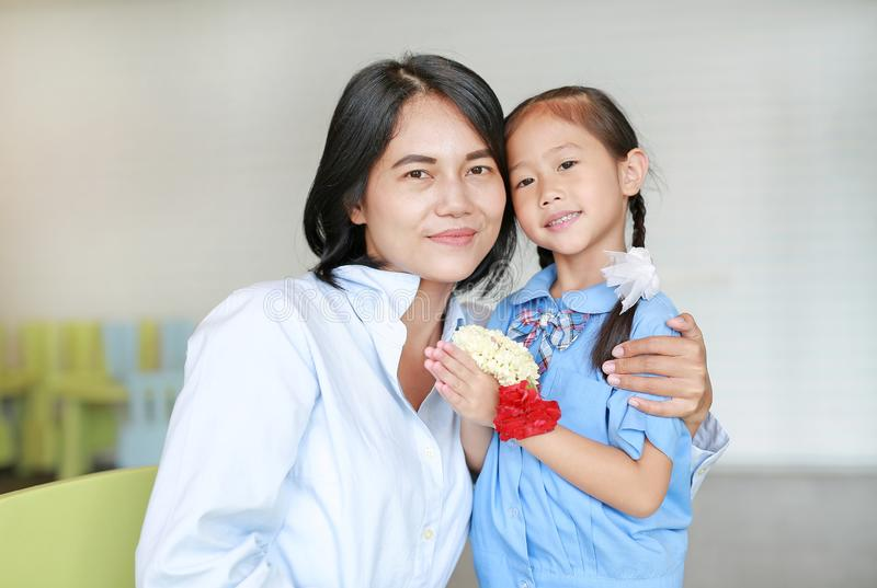 Portrait of happy Asian daughter Pay respect and give Thai traditional jasmine garland to mother. stock photography