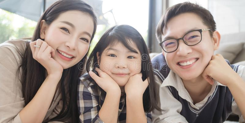 Portrait of happy asian family spending time together in living room. family and home concept. royalty free stock photography