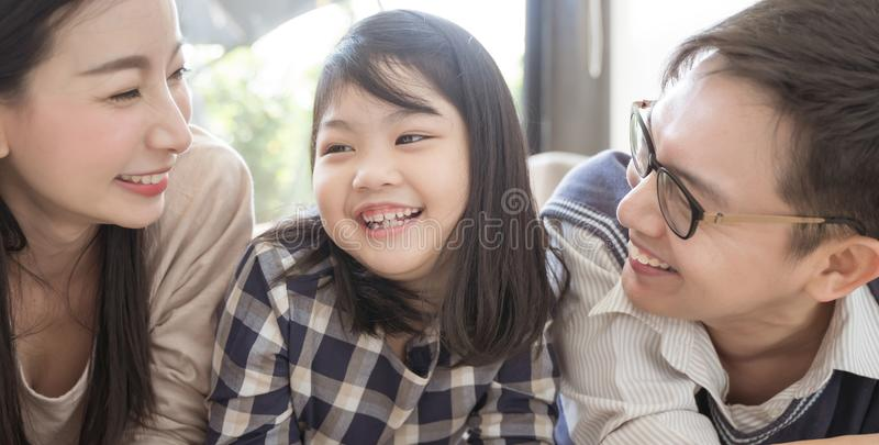 Portrait of happy asian family spending time together in living room. family and home concept. royalty free stock image