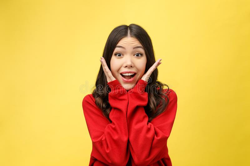 Portrait Happy Asian girl is surprised she is excited.Yellow background studio royalty free stock photos