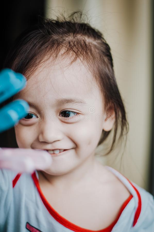 Portrait of a happy Asian little toddler girl. royalty free stock image