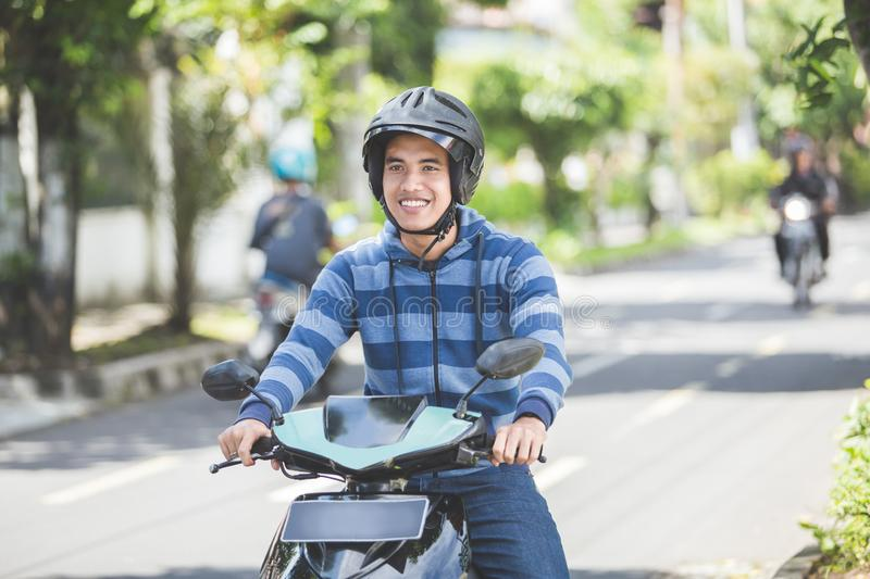 Man riding a motorcyle or motorbike royalty free stock image