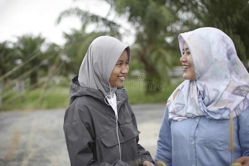 Muslim Mom and Teenager Girl Laughing on Park stock photos