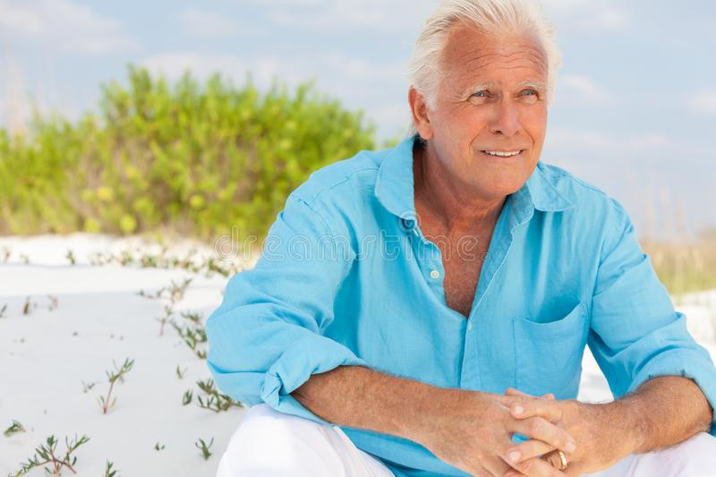 Portrait of Attractive Handsome Senior Man on Beach royalty free stock images