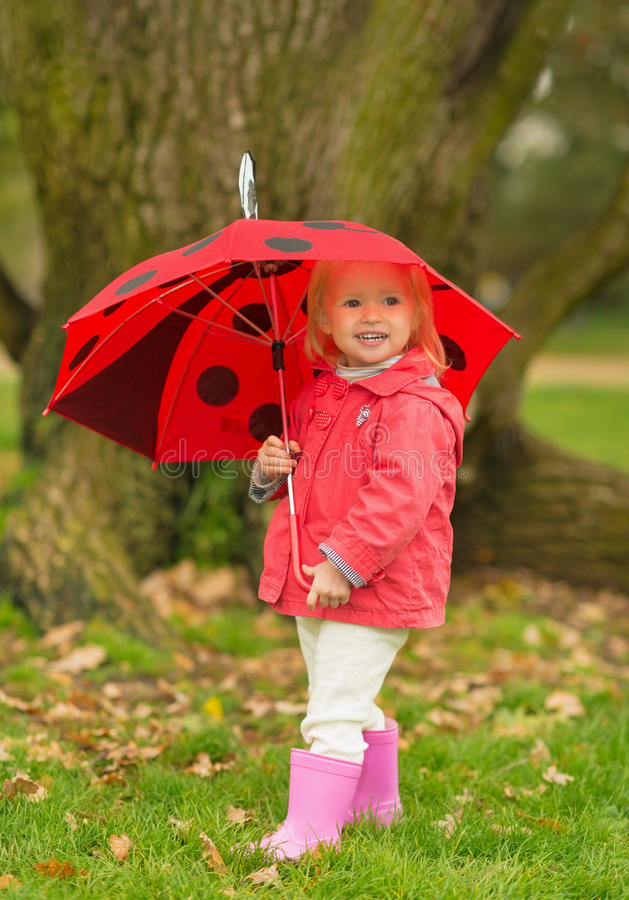 Download Portrait Of Happy Baby With Red Umbrella Outdoors Royalty Free Stock Images - Image: 27443919