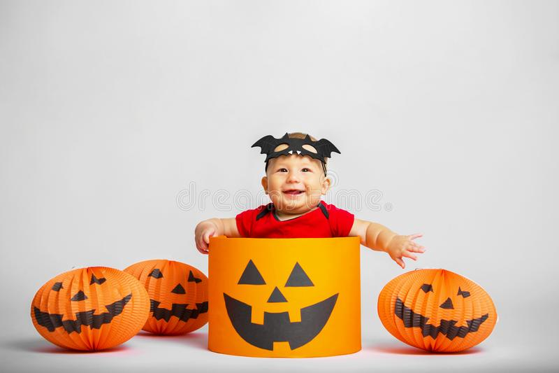 Portrait of a happy child in the style of Halloween. Portrait of a happy baby in the style of Halloween royalty free stock photos