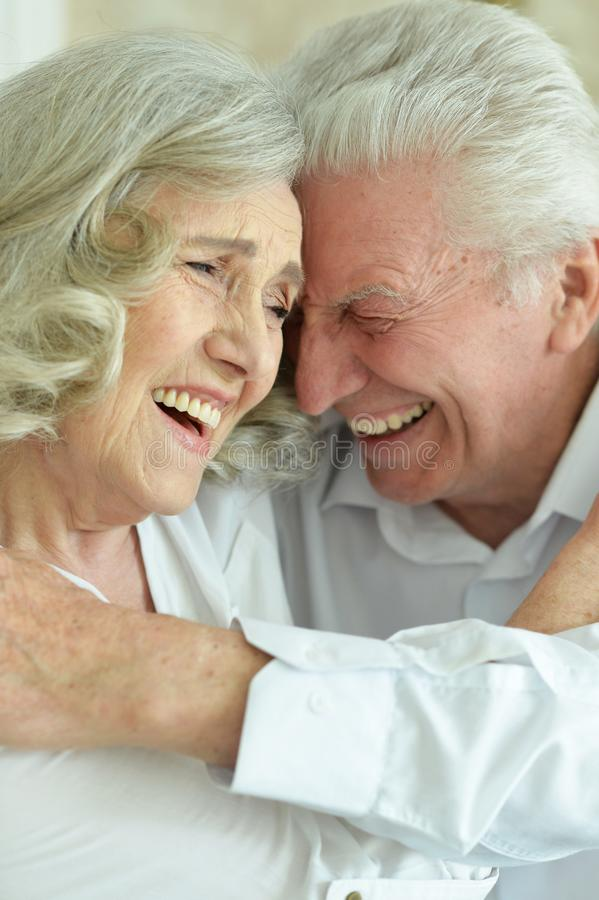 Portrait of happy beautiful senior couple posing at home stock photography