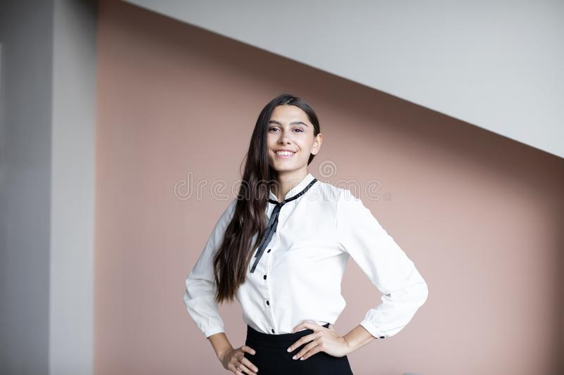 Portrait of happy beautiful young businesswoman smiling looking at camera royalty free stock photo