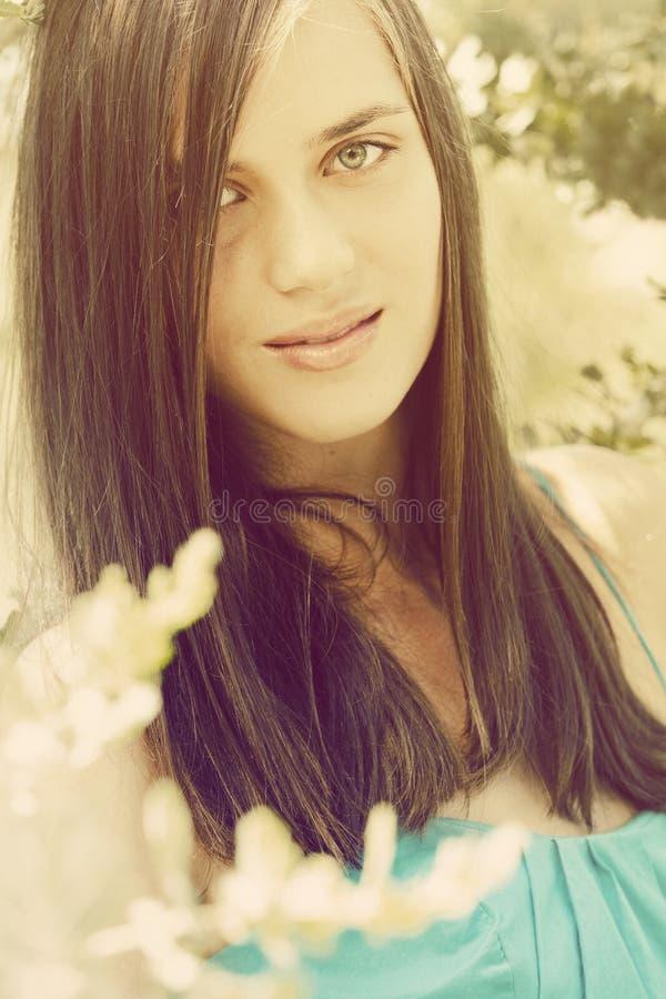 Portrait of happy beautiful young teenage woman