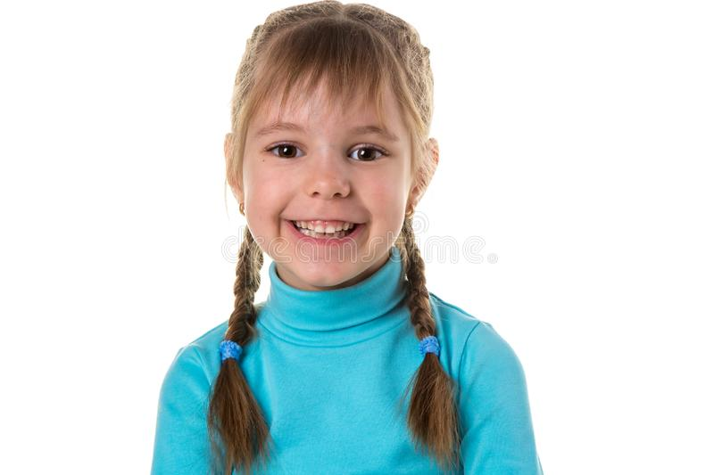 Portrait of happy blond girl with braids smiling looking at camera. White background. royalty free stock image