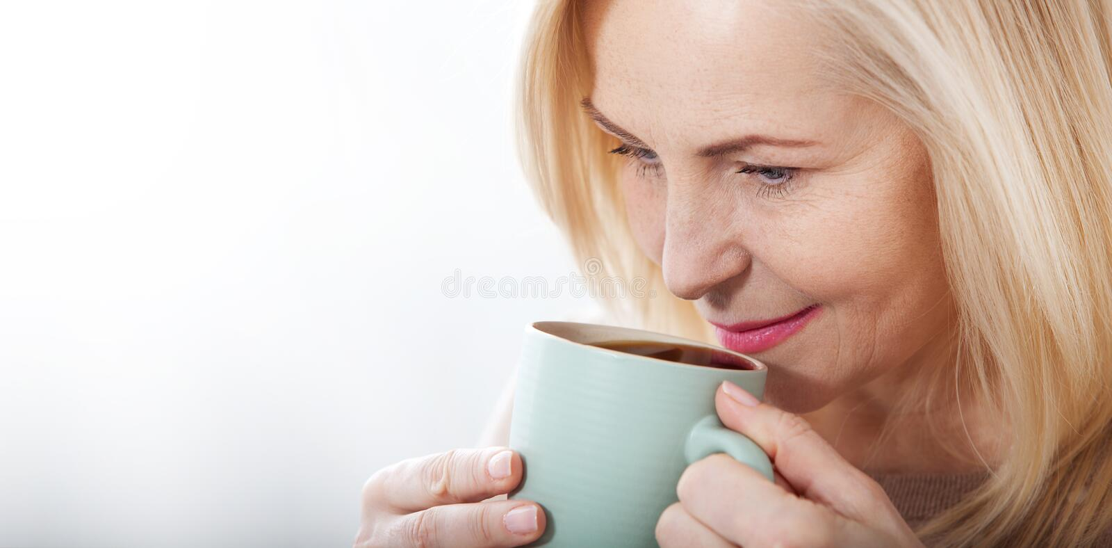 Portrait of happy blonde with mug in hands royalty free stock photos