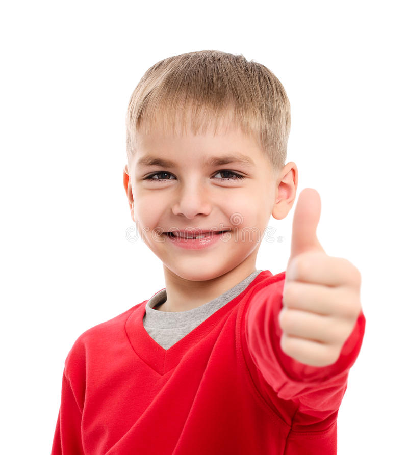 Portrait of happy boy showing thumbs up gesture stock images