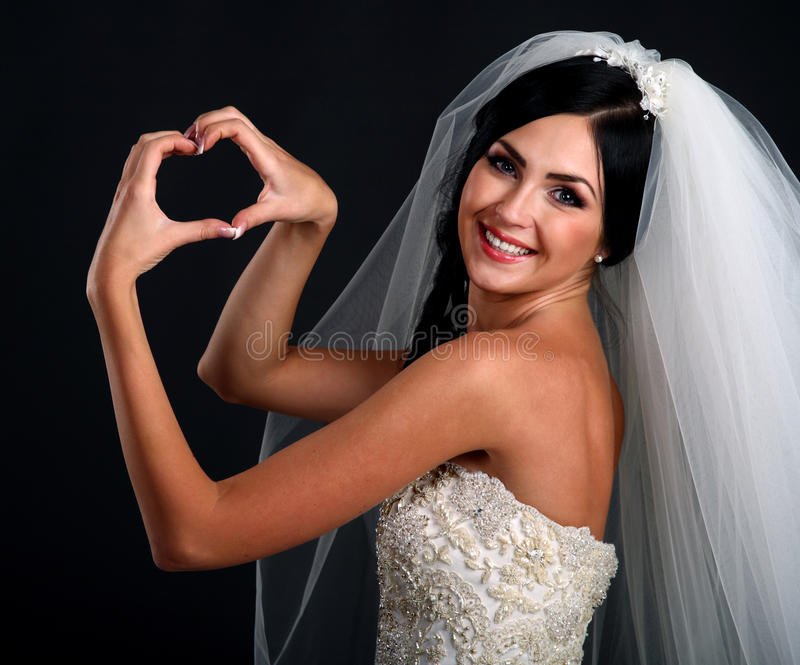 Portrait of happy bride in beautiful dress stock photography