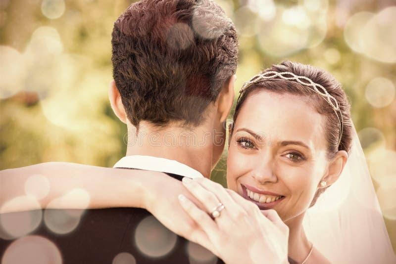 Portrait of happy bride embracing groom stock images