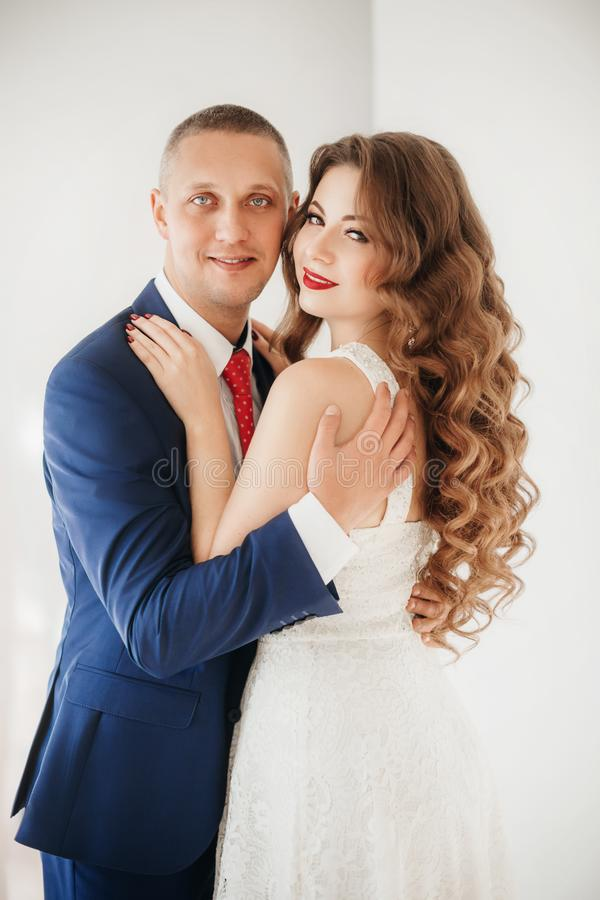 Portrait of  happy bride and groom on their wedding royalty free stock photos