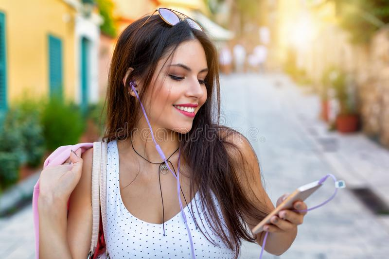 Portrait of an happy, brunette woman in the summer city stock photography