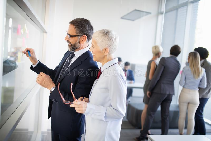 Portrait of happy business people discussing together in office royalty free stock photos