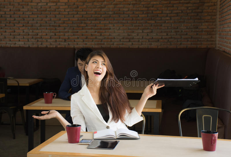 Portrait of happy business woman in coffee shop,Having enjoyed a really impressive success royalty free stock image