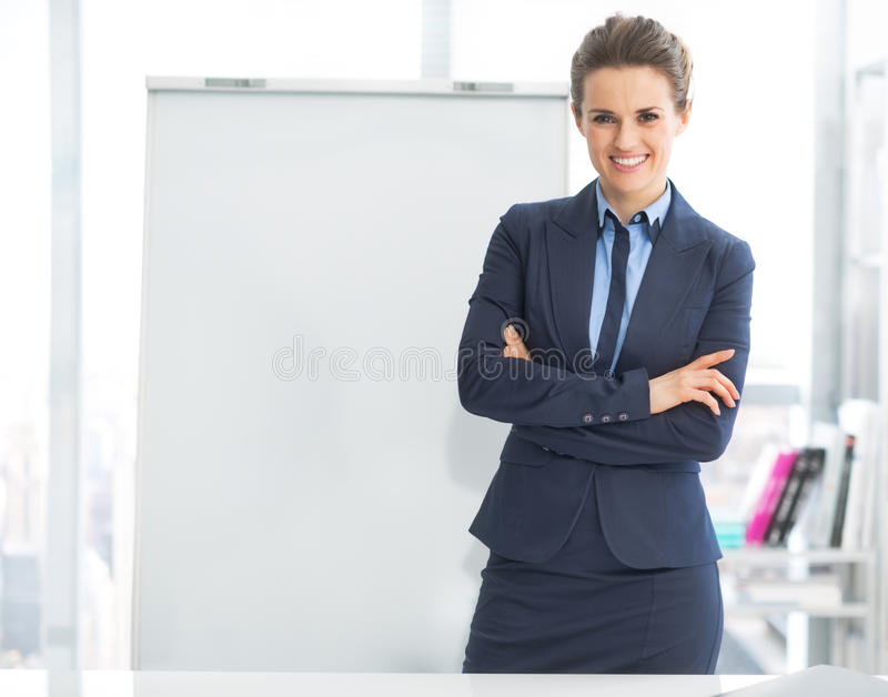 Portrait of happy business woman near flipchart royalty free stock photo