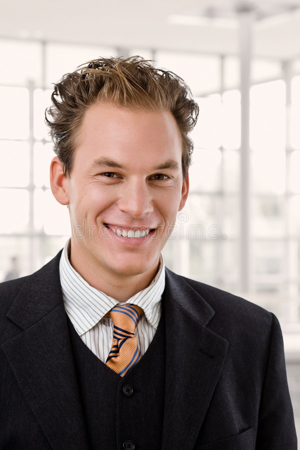 Portrait of happy businessman stock images