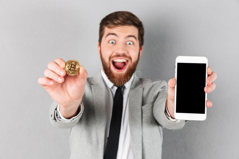 Download Portrait Of A Happy Businessman Holding Bitcoin Stock Photo - Image of blank, finance: 109478866