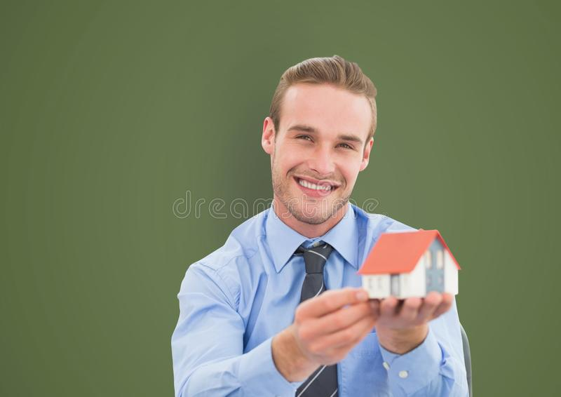 Portrait of happy businessman holding model house royalty free stock photo