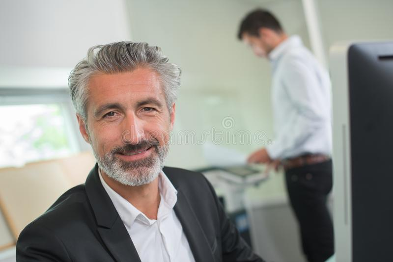 Portrait happy businessman in office stock images