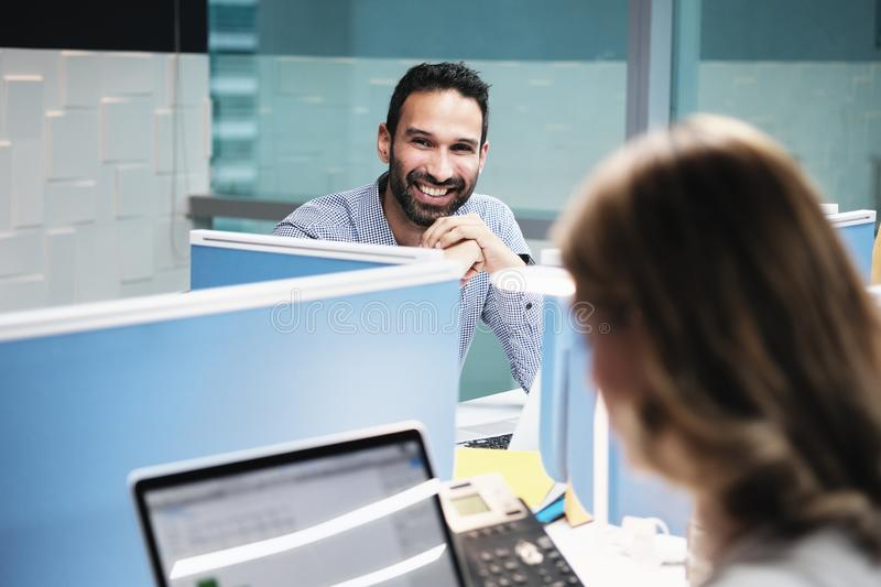 Portrait Of Happy Businessman Smiling At Camera In Coworking Office royalty free stock photos