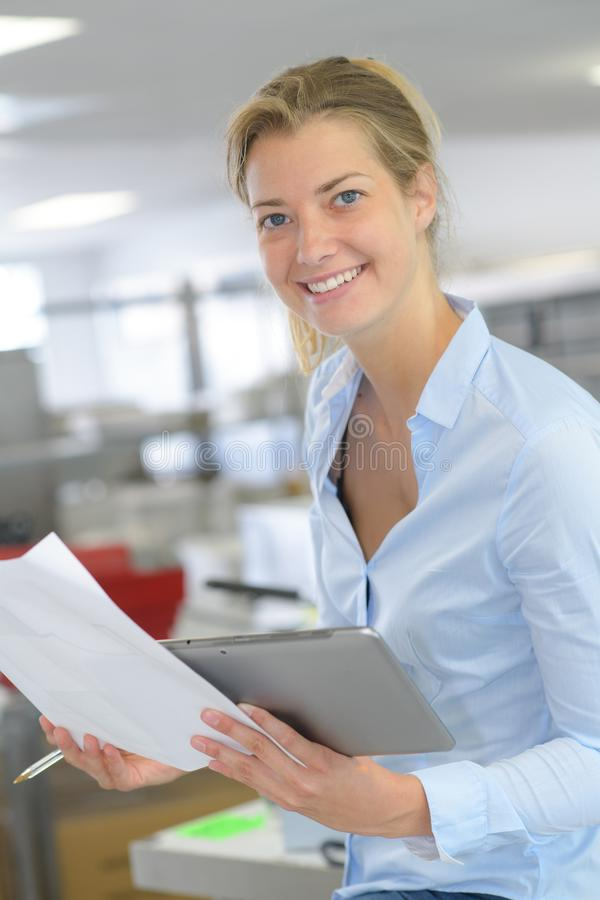 Portrait happy businesswoman holding document royalty free stock photos