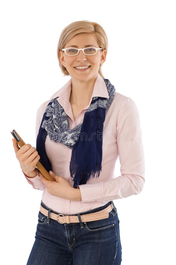 Portrait of happy businesswoman. Happy businesswoman holding folder, smiling, looking at camera stock images