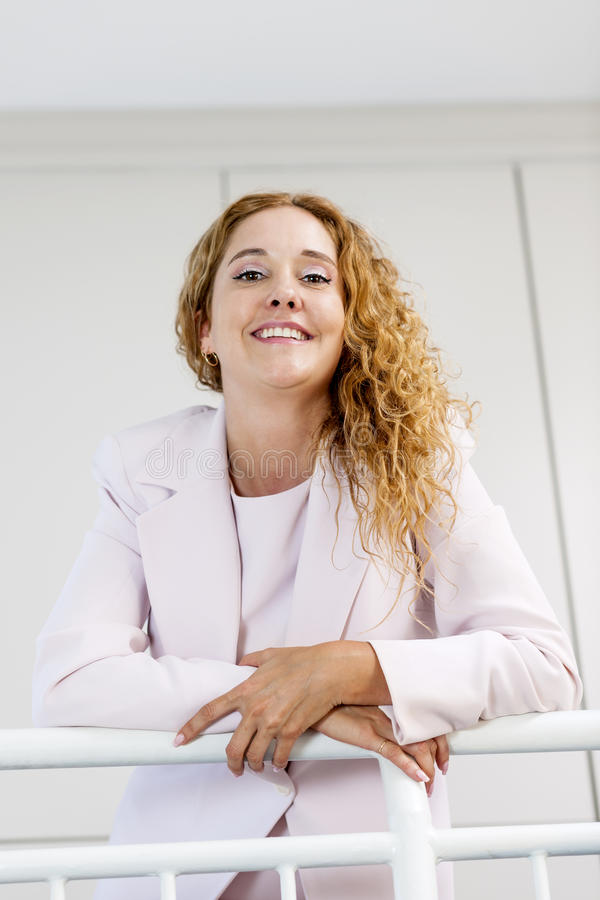Portrait of happy businesswoman in office royalty free stock photos