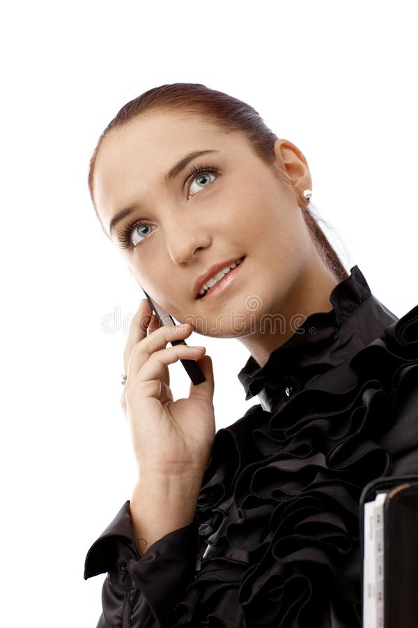 Portrait of happy businesswoman on phone stock images