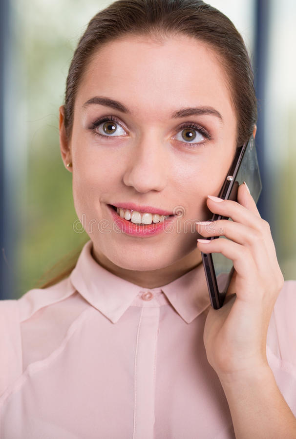 Portrait of happy businesswoman. Portrait of happy young busiensswoman talking on the phone royalty free stock images
