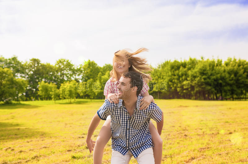 Portrait of Happy Caucasian Couple Playing Outdoors in Summer. H stock photos