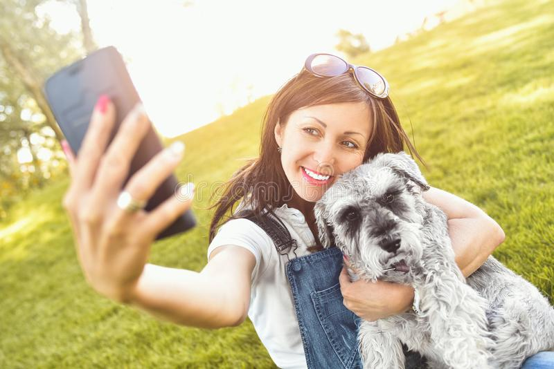 Portrait of a happy caucasian woman who hugs her beloved dog and Makes selfie with him .The concept of love for animals. best stock photos